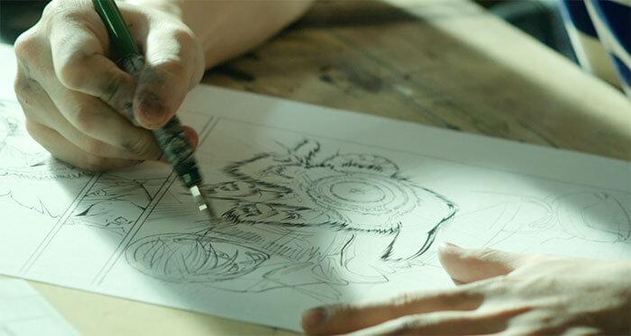 マンガの原稿を描くシーン